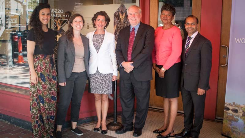 A photo of the Boston Fed Working Cities team with Rhode Island Governor Raimondo and others.