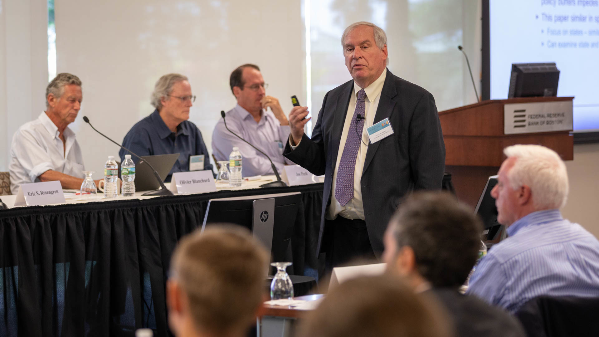 "A photo of Boston Fed President Eric Rosengren presenting a paper he co-authored, ""Some Unpleasant Stabilization Arithmetic,"" at the conference."