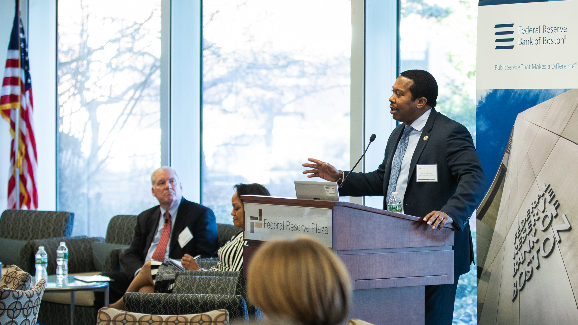 "Photo of Marques Benton introducing the BostonFed & SHE2 the ""Advancing Leading Women in Financial Services"" during the New England Financial Services CEO Roundtable Diversity & Inclusion Conference - featuring panel discussions about increasing the representation of women in financial services."