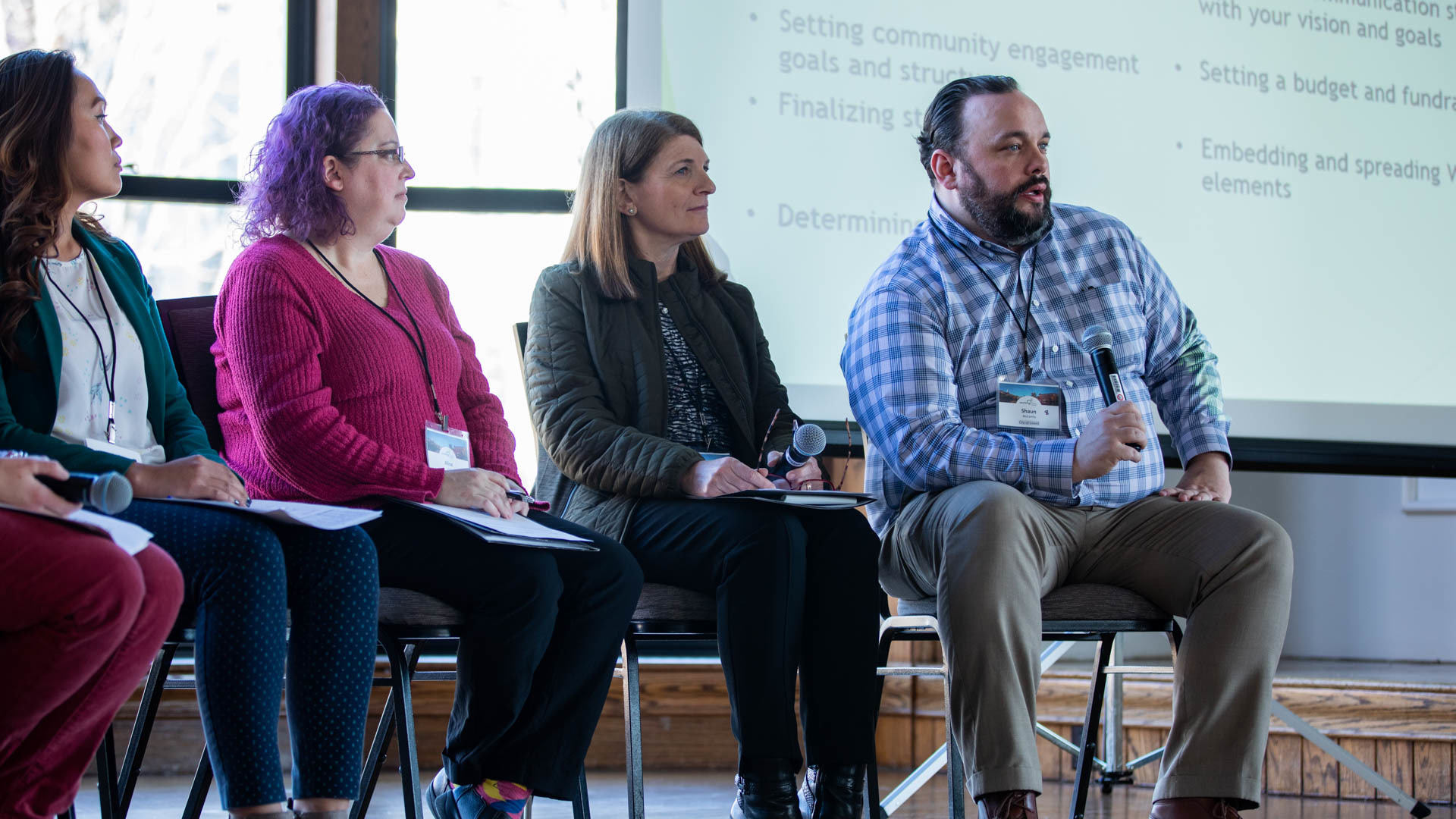 Photo from Working Communities Summit event featuring a second panel with previous winners talking about their experiences.